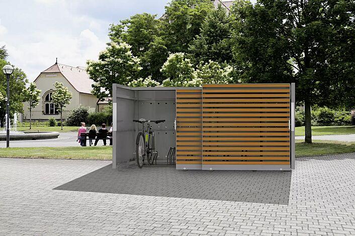 Fahrradgarage STYLEOUT® BIKE L, Rück- und Seitenwände in RAL 7035 lichtgrau, Schiebetüren in Holzdekor Douglasie, Dach Aluminium eloxiert