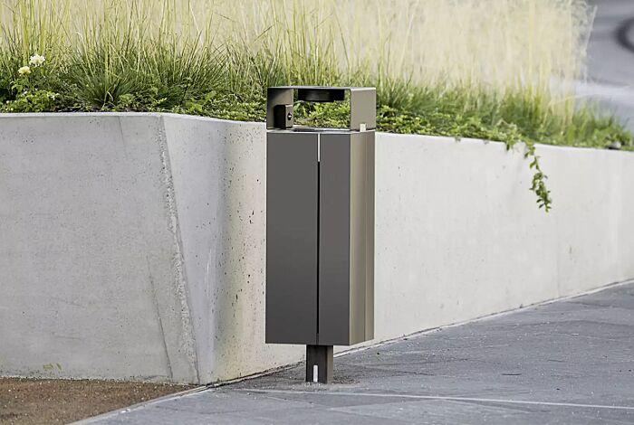 """<div id=""""container"""" class=""""container"""">Abfallbehälter NANUK mit Schutzdach und Ascher, Korpus: Edelstahlblech, Stahlteile in RAL 9007 graualuminium</div>"""