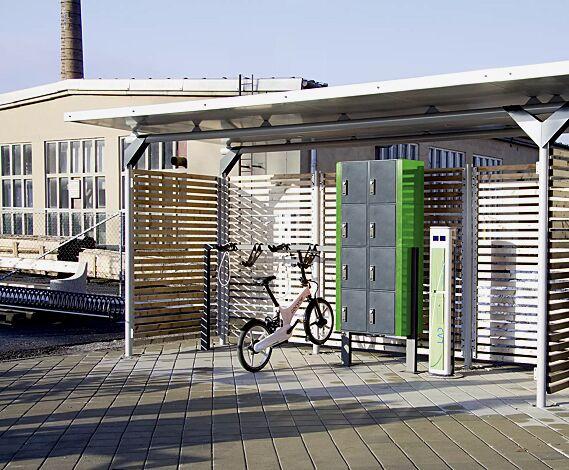 Design-Lenkerhaltesystem UNIT einseitig, 4 Stellplätze, in RAL 7016 anthrazitgrau, integriert in Fahrradüberdachung MATRIX mit Schließfachanlage und Ladesäule