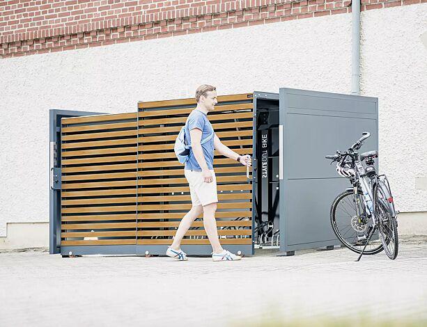 """<div id=""""container"""" class=""""container"""">Fahrradgarage STYLEOUT® BIKE L, Rück- und Seitenwände in RAL 7016 anthrazitgrau, Schiebetüren in Holzdekor Kirschbaum hell, Dach Aluminium eloxiert, mit Ablagefläche und Steckdosenleiste (Mehrpreis)</div>"""