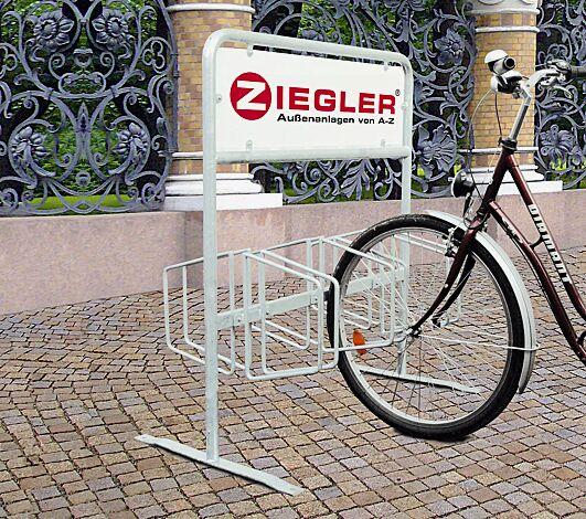 """<div id=""""container"""" class=""""container"""">Fahrradständer MAITLAND mit Werbeschild. 6 Stellplätze, feuerverzinkt</div>"""