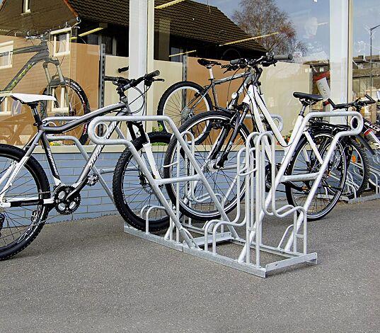 """<div id=""""container"""" class=""""container"""">Fahrradständer MODESTA doppelseitig, 4 Stellplätze, 4 Anlehnbügel</div>"""