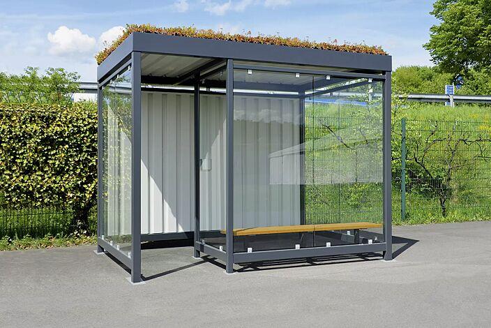 """<div id=""""container"""" class=""""container"""">Raucherunterstand AQUILA GREEN mit auftragsbezogener Anpassung (zusätzliche Windschutzwand), Dachbreite x Dachtiefe 3180 mm x 2165 mm, Rückwand Trapezblech, Seiten- und Windschutzwände, ESG, Klarglas, Sitzbank, Stahlkonstruktion in RAL 7016 anthrazitgrau</div>"""