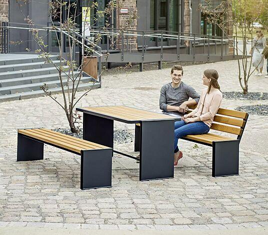 """<div id=""""container"""" class=""""container"""">Bank-Tisch-Kombination NATURA mit Escheholzbelattung, bestehend aus einem Tisch, Sitzbank mit und ohne Rückenlehne, Stahlteile in RAL 7016 anthrazitgrau</div>"""