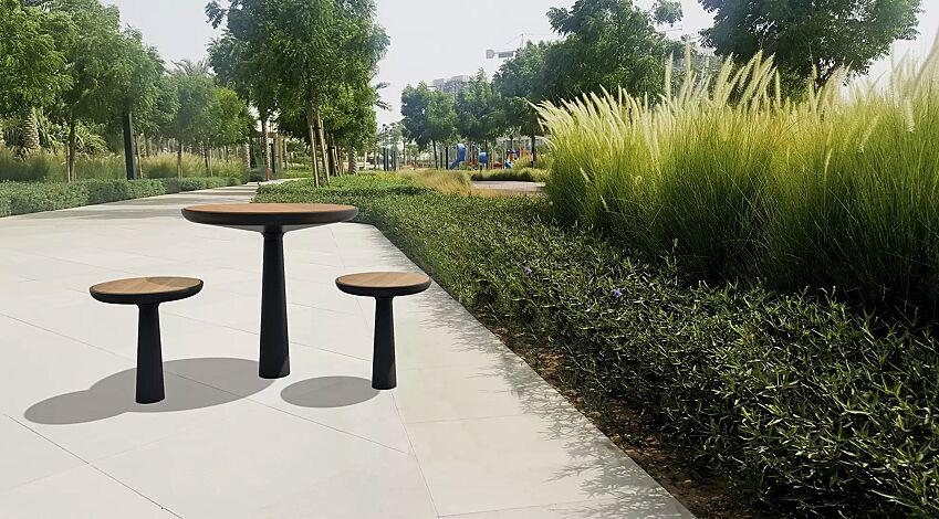 Tisch TEO mit Tischfläche aus Holz, Gusseisenteile in RAL 7016 anthrazitgrau sowie Sitzhocker TEO mit Sitzfläche aus Holz, Gusseisenteile in RAL 7016 anthrazitgrau