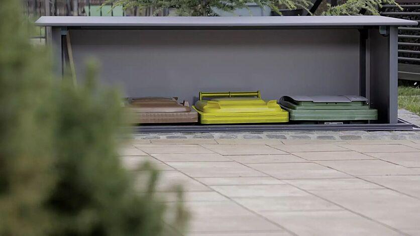 Detail: automatisches Heben und Senken der Mülltonnen