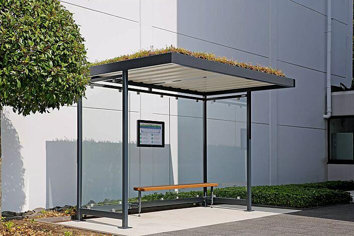 """<div id=""""container"""" class=""""container"""">Wartehalle LEONIS GREEN, Dachbreite x Dachtiefe 3180 mm x 2165 mm, mit Rück- und Seitenwänden, LED-Beleuchtung, mit Schaukasten und Sitzbank, Stahlkonstruktion in RAL 7016 anthrazitgrau</div>"""